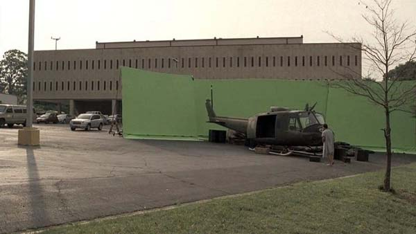 Before: a helicopter body in a parking lot.