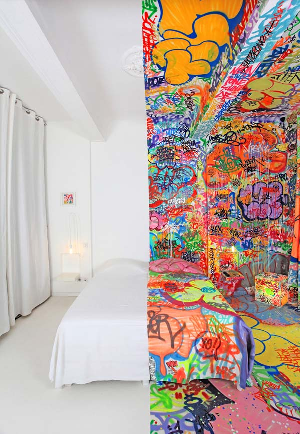One half of the room is pristinely white, while the other is covered in shocking and colorful graffiti.