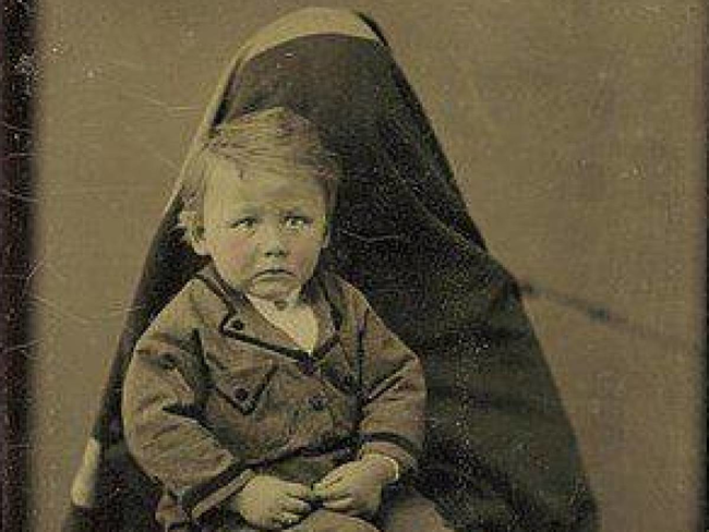 This little boy looks like he was simply terrified into submission.