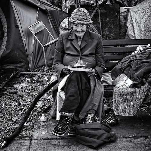 Woman Occupier Enjoying Lunch, Occupy DC, McPherson Square, Washington, DC