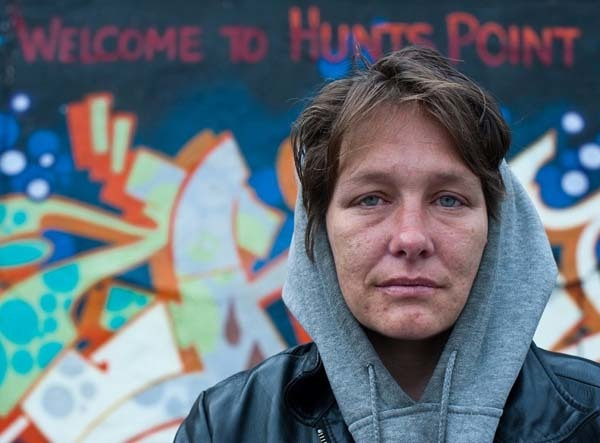 """Sonya lives on the top floor of an abandoned building with her husband of ten years Eric. They left Rhode Island in pursuit of drugs, settling in Hunts Point five years ago. Eric said, 'This is the only reason me and Sonya are in Hunts Point, because this is literally right now the best heroin in all of New York City.' Sonya left her husband and family after being turned on to heroin by Eric. 'I wasn't addicted to drugs until my 30s. Before then, I was a normal person, meaning I wasn't a fucking junkie. I lived in Rhode Island and had a family. I was a soccer mom. I always kind of knew I was a heroin addict. I always knew not to fuck with heroin. I always knew it was the drug for me. It just makes you feel good. And when you're feeling bad, having a magic button is kind of a great thing. Unfortunately the magic button is also a stupid button because it comes with a lot of consequences. I am happier in some ways than I've ever been in my life. But I've lost so many things. I want to get out of my addiction but in some ways it's made me grow a lot. And I think I know now how to live more than I ever have.'"""