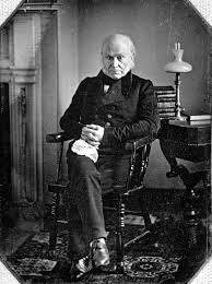 9.) A photograph of John Quincy Adams.