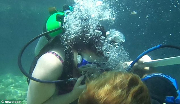 When he asked her to marry him, they were 40ft underwater.