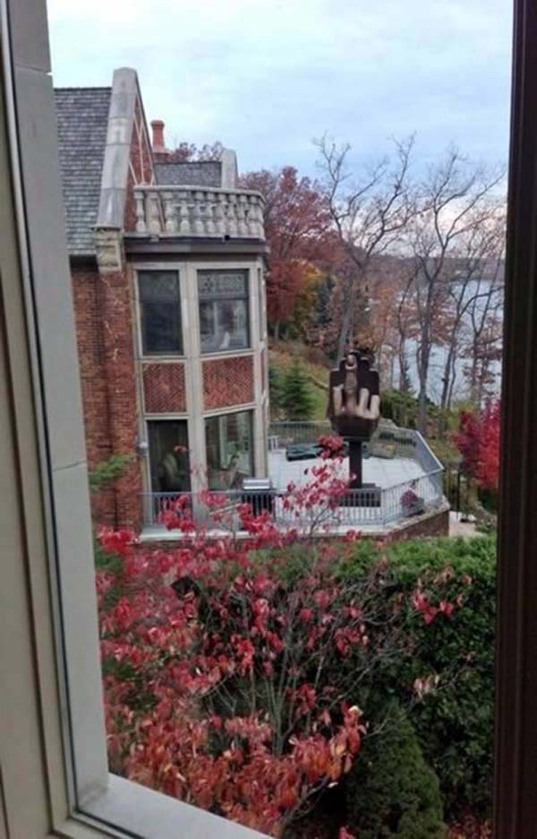 1.) One man bought the house next door to his wife. Then, he erected this giant middle finger.