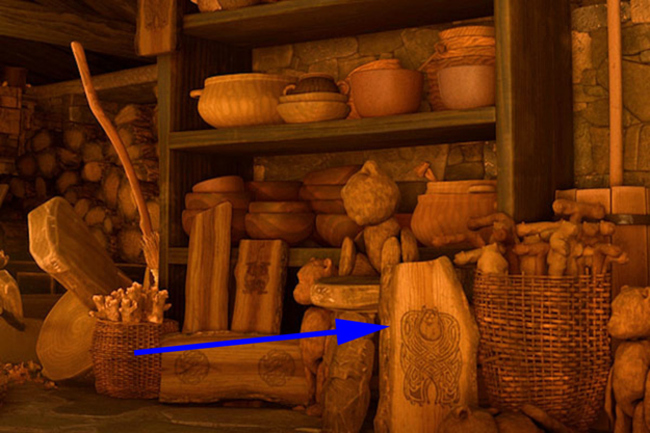 """In """"Brave"""" the witch who turns Merida's mother into a bear has carved Sully from """"Monsters Inc"""" into a log."""