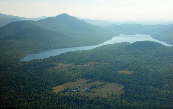 The cabin is situated in the Adirondack Mountains.