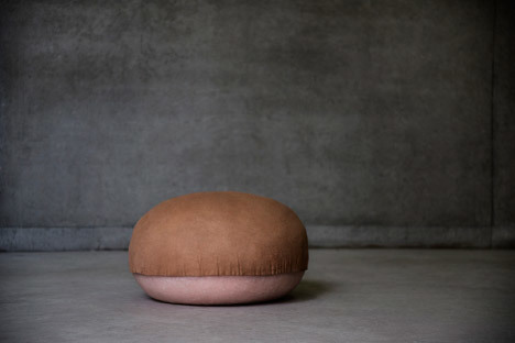 Gigi used molded silicone as a base to create a series of squishy seats designed to mimic rolls of fat. Then she found leather close to human skin in feel and touch to stretch it over the bulbous forms with the suede section facing side up.