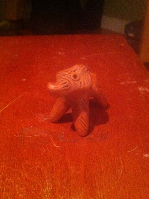 Whoever was living there had small objects with them, like the elephant seen here.