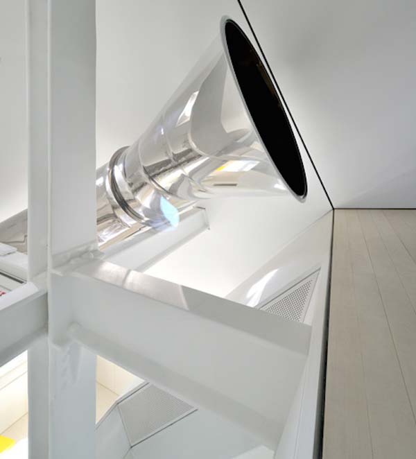 Instead of taking stairs to get around this massive apartment, you take the slide.