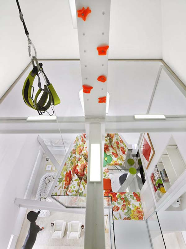 Skyhouse's design mixes fun in with modern ideas. There's a rock wall, a swing...