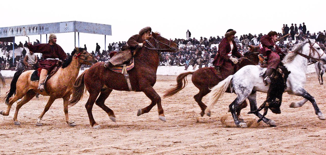 7.) Buzkashi: In parts of the Middle East they like to play a game where the goal is to, while on horseback, get a goat caracas to the other team's side. Sounds fun?