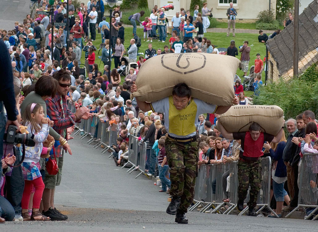 13.) Woolsack Races: People of the world, I give the most British sport ever invented. A bunch of Brits get together and see who can run up a gentle slope the fastest with a giant bag of wool on their backs.