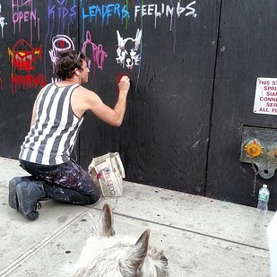 Artist Greg Siff, paints Elmo's portrait.