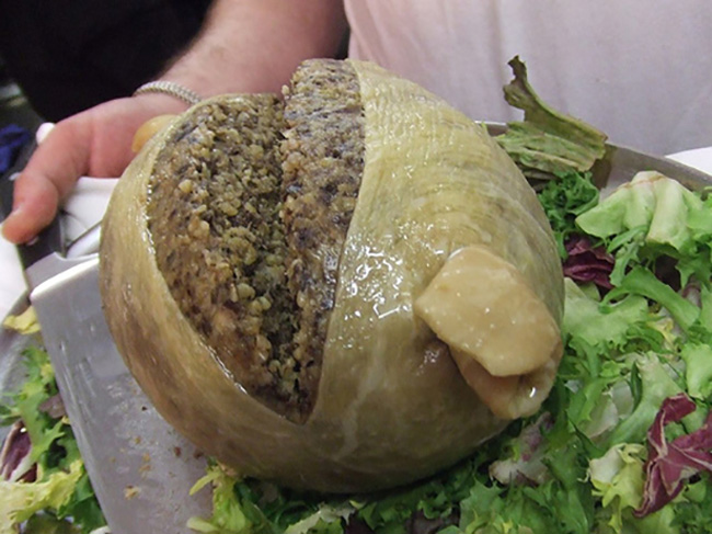 5) Haggis - This traditional Scottish dish is made from a sheep's stomach stuffed with diced sheep's liver, lungs and heart, oatmeal, onion, suet and seasoning. You know, all that tasty stuff.